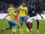 Sweden's midfielder Albin Ekdal vies with French forward Guilavogui during the friendly football match France vs Sweden on November 18, 2014