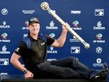 Henrik Stenson of Sweden with the DP World Tour Championship trophy after the final round of the DP World Tour Championship at Jumeirah Golf Estates on November 23, 2014