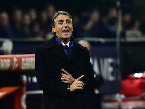 Inter Milan's coach Roberto Mancini gestures during the Serie A football match between AC Milan and Inter at San Siro Stadium in Milan on November 23, 2014