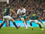 Jared Payne of Ireland is tackled by Bismarck Du Plessis and Francois Houggard of South Africa during the 2014 Guinness series International match between Ireland and South Africa at Aviva Stadium on November 8, 2014