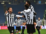 Juventus' midfielder from France Paul Pogba is congratulated by Juventus' midfielder Claudio Marchisio and Juventus' forward from Argentina Carlos Tevez during the Italian Serie A football match between Lazio Rome and Juventus on November 22, 2014