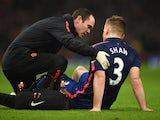 Luke Shaw of Manchester United receives treatment during the Barclays Premier League match between Arsenal and Manchester United at Emirates Stadium on November 22, 2014