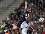 Bordeaux's French defender Nicolas Pallois vies with Marseille's French defender Rod Fanni on November 23, 2014