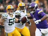 Teddy Bridgewater #5 of the Minnesota Vikings avoids the defense in the first quarter against the Green Bay Packers on November 23, 2014