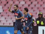 Gonzalo Higuain of Napoli celebrates after scoring his team's opening goal during the Serie A match between SSC Napoli and Cagliari Calcio at Stadio San Paolo on November 23, 2014