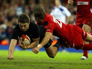 New Zealand's fly half Beauden Barrett runs in a try during the Autumn International rugby union Test match between Wales and New Zealand at the Millennium Stadium in Cardiff, south Wales, on November 22, 2014