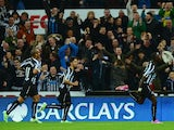 Moussa Sissoko of Newcastle United celebrates scoring the opening goal with team mates during the Barclays Premier League match between Newcastle United and Queens Park Rangers at St James' Park on November 22, 2014