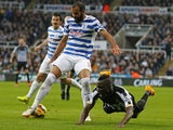 Queens Park Rangers' Brazilian midfielder Sandro vies with Newcastle United's French defender Massadio Haidara during the English Premier League football match between Newcastle United and Queens Park Rangers at St James' Park in Newcastle-upon-Tyne, nort