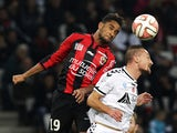 Reims' French forward Gaetan Courtet (R) heads the ball with Nice's French forward Jordan Amavi during the French L1 football match between Nice and Reims at the Allianz Riviera stadium in Nice, southeastern France, on November 22, 2014