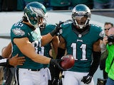 Josh Huff #11 of the Philadelphia Eagles celebrates his touchdown with teammate James Casey #85 in the first quarter against the Tennessee Titans at Lincoln Financial Field on November 23, 2014