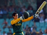 South Africa's batsman Quinton de Kock celebrates his 100 runs against Australia during their fifth one-day international cricket match in Sydney on November 23, 2014