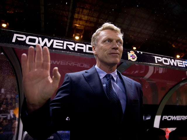 Head coach David Moyes of Real Sociedad de Futbol waves prior to start the La Liga match between RC Deportivo La Coruna and Real Sociedad de Futbol at Riazor Stadium on November 22, 2014