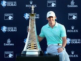 Rory McIlroy of Northern Ireland poses with the Race To Dubai trophy after winnng The Race To Dubai at the DP World Tour Championship at Jumeirah Golf Estates on November 23, 2014
