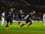 Andrew Robertson of Scotland celebrates scoring their first goal during the International Friendly between Scotland and England at Celtic Park Stadium on November 18, 2014