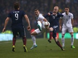 England's midfielder Jack Wilshere vies with Scotland's striker Steven Naismith during the international friendly football match between Scotland and England at Celtic Park in Glasgow, Scotland, on November 18, 2014