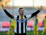 Antonio Di Natale of Udinese Calcio celebrates after scoring his opening goal and his 200th goal in Serie A during the Serie A match between Udinese Calcio and AC Chievo Verona at Stadio Friuli on November 23, 2014
