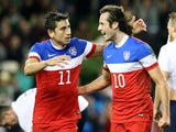 United States' midfielder Mix Diskerud celebrates with United States' midfielder Alejandro Bedoya after scoring their first goal to equalise during the international friendly football match between the Republic of Ireland and the United States at the Aviv