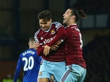 Mauro Zarate of West Ham United celebrates his goal with Andy Carroll during the Barclays Premier League match between Everton and West Ham United at Goodison Park on November 22, 2014