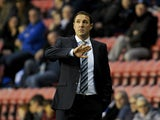 Wigan Athletic Manager Malky Mackay gestures during the Sky Bet Championship match between Wigan Athletic and Middlesbrough at DW Stadium on November 22, 2014