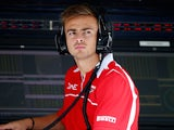 Will Stevens of Marussia looks on from the pit wall during practice for the Japanese Formula One Grand Prix at Suzuka Circuit on October 3, 2014