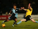 Paris Cowan-Hall of Wycombe is tackled by Darragh Lenihan of Burton during the Sky Bet League Two match between Wycombe Wanderers and Burton Albion at Adams Park on November 17, 2014