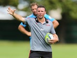 Assistant coach Aaron Mauger gives instuctions during a Crusaders Super Rugby training session at Rugby Park on February 19, 2014