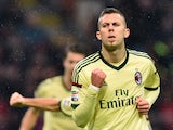 AC Milan's midfielder from France Jeremy Menez celebrates after scoring during the Serie A football match AC Milan vs. Udinese at San Siro Stadium in Milan on November 30, 2014