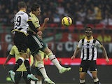 Marco Van Ginkel of AC Milan competes for the ball with Guillerme Dos Santos Torres of Udinese Calcio during the Serie A match between AC Milan and Udinese Calcio at Stadio Giuseppe Meazza on November 30, 2014