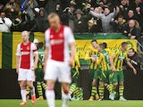 ADO Den Haag player Michiel Kramer celebrates his 1-1 with his teammates during the Dutch Eredivisie football match between ADO Den Haag and Ajax Amsterdam in The Hague on November 30, 2014
