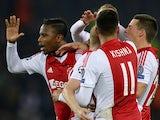 Ajax Amsterdam's player celebrate after their Dutch midfielder Davy Klaassen scored a goal during the UEFA Champions League group F football match between Paris Saint-Germain and Ajax Amsterdam on November 25, 2014