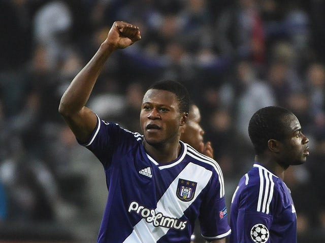 Anderlecht's defender from DR Congo Chancel Mbemba celebrates after scoring his second goal during the UEFA Champions League football match between Anderlecht and Galatasaray in Brussels, November 26, 2014