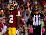 Wide receiver Andre Roberts #12 of the Washington Redskins celebrates after scoring a 4th quarter touchdown against the Seattle Seahawks at FedExField on October 6, 2014