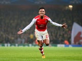 Alexis Sanchez of Arsenal celebrates after scoring his team's second goal during the UEFA Champions League Group D match between Arsenal and Borussia Dortmund at the Emirates Stadium on November 26, 2014