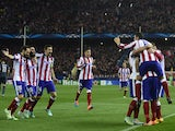 Atletico Madrid's players celebrate after scoring their fourth goal during the UEFA Champions League Group A football match Club Atletico de Madrid vs Olympiakos FC at the Vicente Calderon stadium in Madrid November 26, 2014