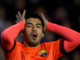 Luis Suarez of FC Barcelona reacts as he fail to score during the La Liga match between Valencia CF and FC Barcelona at Estadi de Mestalla on November 30, 2014