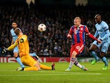 Sebastian Rode of Bayern Muenchen has his shot on goal saved by Joe Hart of Manchester City during the UEFA Champions League Group E match between Manchester City and FC Bayern Muenchen at the Etihad Stadium on November 25, 2014