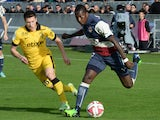 Bordeaux' Abdou Traore vies with Lille's Jonathan Delaplace during the French L1 football match Girondins de Bordeaux vs LOSC Lille on November 30, 2014