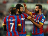 Mile Jedinak of Crystal Palace celebrates with team mates as he scores their first and equalising goal from a penalty during the Barclays Premier League match between Swansea City and Crystal Palace at Liberty Stadium on November 29, 2014