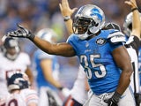 Joique Bell #35 of the Detroit Lions celebrates a second quarter touchdown against the Chicago Bears at Ford Field on November 27 , 2014