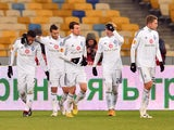 Jeremain Lens of FC Dynamo Kiev is congratulated by teammates after scoring a goal during the UEFA Europa League group J football match Dynamo Kiev vs Rio Ave FC in Kiev on November 27, 2014