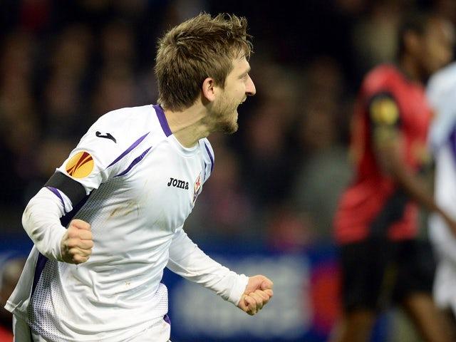 Fiorentina's German midfielder Marko Marin celebrates after opening the scoring during the Europa League Group K football match Guingamp vs Fiorentina on November 27, 2014