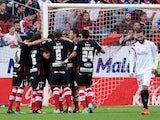 Granada's Moroccan forward Youssef El-Arabi celebrates with his teammates after scoring during the Spanish league football match Sevilla FC vs Granada FC at the Ramon Sanchez Pizjuan stadium in Sevilla on November 30, 2014
