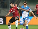 Hoffenheim's Swiss midfielder Pirmin Schwegler and Hanover's midfielder Lars Stindl vie for the ball during the German first division Bundesliga football match 1899 Hoffenheim vs Hannover 96 in Sinsheim, southwestern Germany, on November 29, 2014
