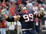 J.J. Watt #99 of the Houston Texans celebrates a sack in the first half of their game against the Tennessee Titans at NRG Stadium on November 30, 2014