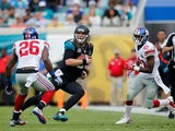 Blake Bortles #5 of the Jacksonville Jaguars carries while defended by Antrel Rolle #26 of the New York Giants during the second quarter of the game at EverBank Field on November 30, 2014