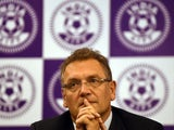 Jerome Valcke gestures during a joint press conference with Indian parliamentarian and president of the All India Football Federation, Praful Patel in New Delhi on October 15, 2014