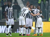 Juventus' midfielder Andrea Pirlo celebrates with teammates after scoring during the Italian Serie A football match Juventus Vs Torino on November 30, 2014