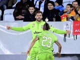Juventus' forward Fernando Llorente celebrates with his teammate midfielder Arturo Vidal after scoring a goal the UEFA Champions League group A football match Malmo FF vs Juventus at the Swedbank Stadion in Malmo, Sweden on November 26, 2014