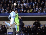 Juventus' forward Carlos Tevez and Malmo's defender Erik Johansson vie for the ball during the UEFA Champions League group A football match Malmo FF vs Juventus at the Swedbank Stadion in Malmo, Sweden on November 26, 2014