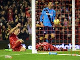 Liverpool's English striker Rickie Lambert celebrates as Liverpool's English defender Glen Johnson scores during the English Premier League football match between Liverpool and Stoke City at Anfield in Liverpool, north west England on November 29, 2014